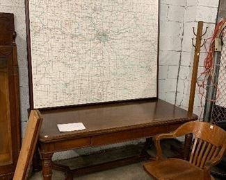 Giant framed map of Kansas City, wooden desk and office chair