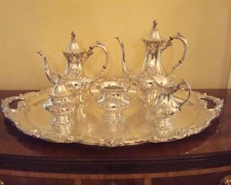 """Dining Room:  Absolutely stunning REED & BARTON """"King Francis"""" six-piece silver-plate tea set is in excellent condition.  The set includes the coffee pot, tea pot, cream pitcher, sugar bowl, waste bowl, and gorgeous double-handle tray.  This service was first introduced by REED & BARTON in 1975 and remains a classic today."""