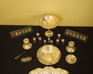 Dining Room-CASE:  These sterling silver pieces are displayed in the glass case.  Included are:  a compote, salt & pepper shakers, candlesticks, a small round bowl, an oval dish, candle snuffer, a baby's food pusher, and sterling handle baby brush.  NOTE:  All  sterling has been removed from the home and will return on Saturday morning.