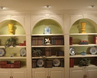 """Living Room:  The built in bookcases are decorated with single books and multi-volume book sets as well as various décor, including the two yellow/gold vases by CHELSEA HOUSE, an ORREFORS blue crystal bowl, a porcelain Lipizzaner horse figure, SPODE plates, small faux ivy in brass planters, and more!  Book sets include:  """"Little Masterpiece of American Wit & Humor"""" (1903-1904) (now displayed in glass case in dining room) ; 8-Volume Set by Rudyard Kipling (early 1900s); 12-Volume Set of """"The After School Library; 54-volume set of Britannica """"Great Books of the Western World"""" (1950's); and various leather bound classics, including """"Gulliver's Travels,"""" """"Little Women,"""" and Charles Dickens' """"Great Expectations."""""""