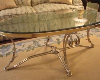"""Living Room:  This is the most elegant cocktail table!  It is made of polished steel and hand-cast brass with a glass top, and measures 52"""" wide x 32"""" deep x 21"""" tall."""