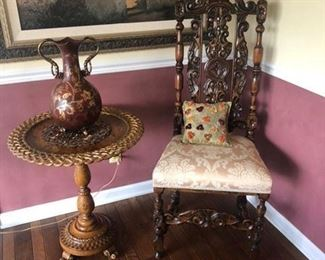 pair of highly carved chairs from prominent New Orleans specialty shop.