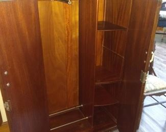 This piece is in the basement and can be used as a wardrobe, cabinet for linens, etc...