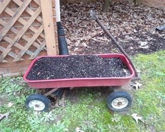 Obviously this was used as a planter but you could use this cute red wagon for anything!