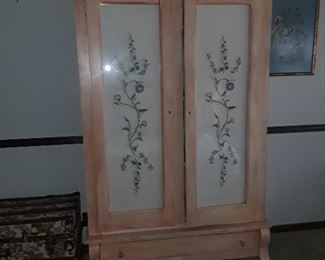 Hand embroidered pieces in glass doors armoire