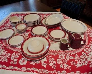 Buffalo China burgundy-edged setting for 12 plus assorted coordinating pieces by other makers. Vintage matching table linens.