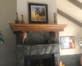 This beautiful carved mantel with elephant cornels will be taken down by contractor and daily moved by whoever buys this.