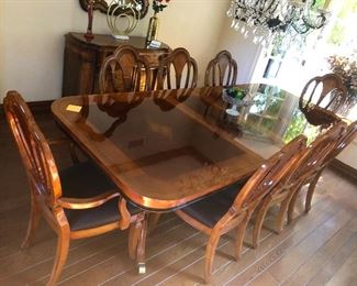beautiful formal dining room table with 8 matching chairs...