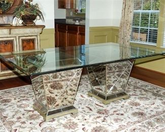 1. Modern Glass Top Table with Mirrored Supports