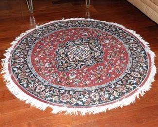 6. Circular Rug with Floral Motif