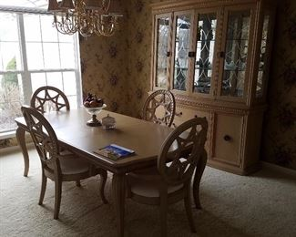 Dining room set shows extra leaf in table. There is one additional leaf not shown.