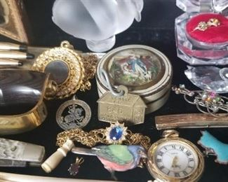 just a few of  the fun things we have found at this sale Gold baby rings' pocket knife coins etc