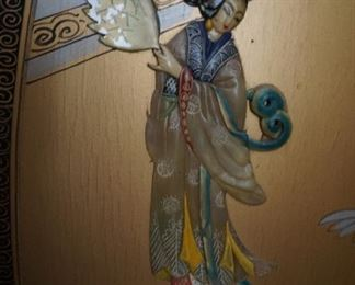 Close up of applied maiden using different natural stones and hand painted.