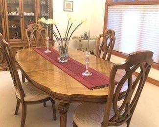 Thomasville Dining room furniture in MINT condition.   Includes China Cabinet, table and chairs.