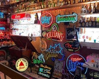Neon signs, primitive dough bin full of beer trays