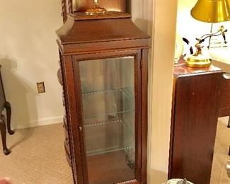Mahogany display cabinet by Brandt Furniture featuring 4 glass side, 3 levels for display. A very nice piece!