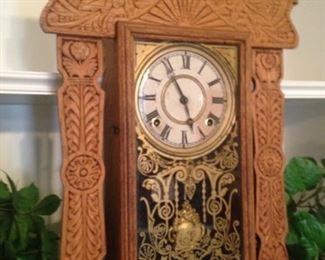 Carved antique mantel clock