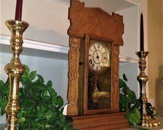 Pair of brass candleholders; antique mantel clock