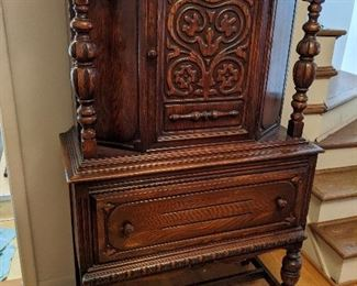 $175  Ornate wood tall cabinet