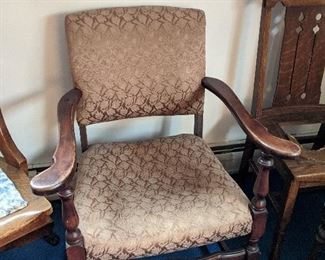 $30  Wood arm upholstered chair