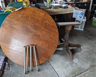 $50  Round oak table with wood base