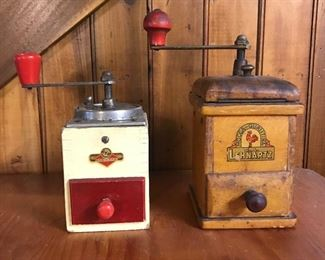 Collection of antique coffee grinders.