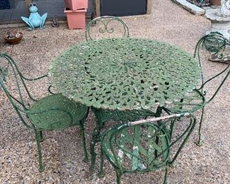 I've seen many ice cream style patio sets but this one takes the CAKE. Heavy duty wrought iron and vintage pattern. This is one you won't see again for some time!