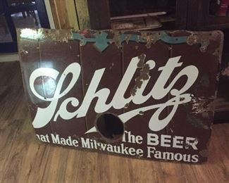 1930's porcelain Schlitz sign. Hole was for stove pipe