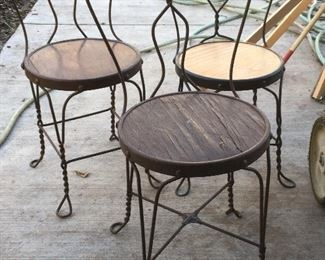 Antique ice cream chairs, 2 painted brown and one black.