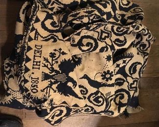 Woven coverlet from  Delhi New York dated 1850 with eagle in the corners, most of damage is just sewing the panels back together. Two colors: navy one side and beige other side. Probably cotton or linen. Stunning!