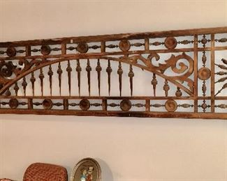 large wood ornamental piece on wall on lower level
