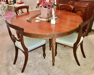 antique dining table with hand made leaves extends to 111.5 inches