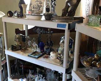 Big blue ceramic dogs, taxidermy fox head, Christian Cross, etc