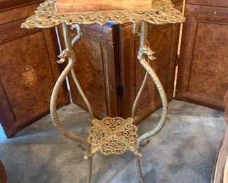 Marble top cast iron plant stand