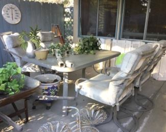 Patio umbrella table and four swivel chairs