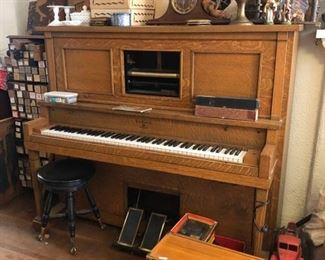 Great player piano in working condition. Includes music rolls as pictured on the left.