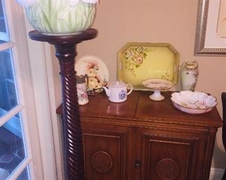 a Mid Century server, a tall fern stand and lots of fine porcelain
