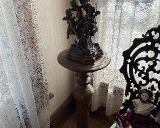 Plant stand, pristine cherub statue.  Lace curtains!
