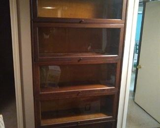 This is a barrister bookcase by Gunn, hard to find.  Five high.  Nice.