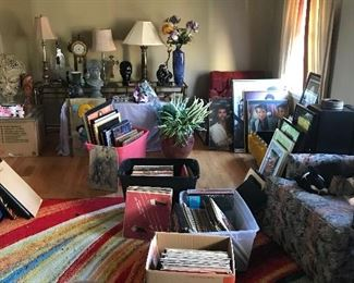 Along with all of the celebrity memorable in this room, we have several lamps to choose from. The table that the lamps are sitting on is for sale also.  There are quite a few vinyl record albums from the 80's disco era. There are a few other genres mixed in as well.