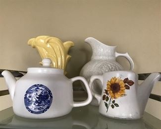 McCoy pottery- yellow swan vase, Blue Willow teapot and sun flower watering can