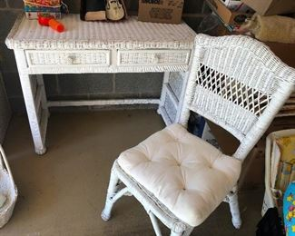 Wicker desk with diaper-clad chair