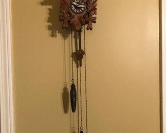 Cuckoo clock or wooden Man-o-war with long metal tenticles