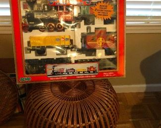 Vintage train set and super cool mid-century modern round rattan ottoman by a famous designer that I will google and get back to you about