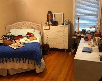 Rebellious teenage daughter dyed her bangs blue. Wicker bedroom set.