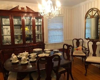 Lovely dining set with china cabinet and dining table where people presumably eat hearty meals but not me because all I can have it clear broth and Pedialite.