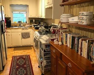 What a cute galley kitchen. I wonder if there is any clear broth in there. Never mind, I have some here instead of wine. How I suffer for you.