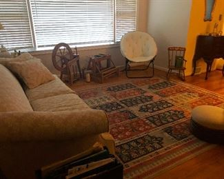 large area rug with lots of interesting things swept under it