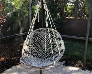 Seated hammock with foot rest and stand.