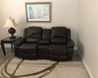 Love seat with 2 recliner seats and center console.  Dark brown leather